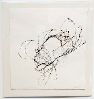 Abstract design resembling a loose nest wire pressed in black ink white paper.