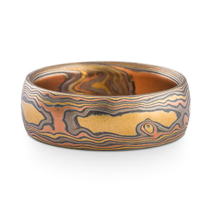 Mokume gane ring arn krebs, wedding band or ring, woodgrain pattern and firestorm palette, firestorm metal combination is red gold palladium silver and yellow gold, yellow gold is most prominent in this ring