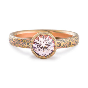 Mokume Gane ring or engagement ring arn krebs, pink sapphire in a mokume bezel, droplet pattern and fire palette, yellow gold red gold and silver