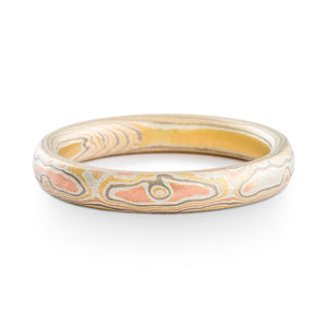 Mokume Gane ring arn krebs woodgrain pattern firestorm palette, this metal palette is made of red gold yellow gold palladium and silver, ring has an etched finish with no oxidation, giving it an overall lighter appearance.