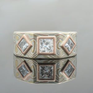 Mokume Gane Ring or Wedding Band in Wave Pattern w/ Moissanite Diamonds and Red Gold Bezel Settings Mokume Gane Ring or mens Wedding Band matching wedding bands custom bespoke 14K white gold yellow gold two tone two toned square ring square shaped ring hexagon mens engagement ring unique bezel set square diamond diamonds woodgrain Pattern silver palladium alternative metal nature inspired rustic artisan topographical earthy style unique handmade matching wedding bands mens womens custom wedding band