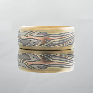 Mokume gane ring mens wedding band Feathered mokume gane design in yellow gold, oxidized silver, palladium and red gold. With rails Contemporary bespoke mixed metal tricolor rose gold topographical woodgrain pattern nature inspired artisan made handmade