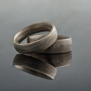Mokume Gane Wedding Ring Set or wedding band set twisted metal Pattern Woodgrain Pattern black blackened oxidized silver palladium alternative metal nature inspired rustic artisan topographical earthy style woodgrain unique handmade wedding band mens in Embers Palette and Flow Pattern