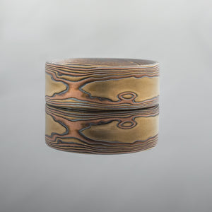 mokume gane ring mens wedding band unique in red rose gold, yellow gold, and oxidized silver woodgrain pattern nature inspired masculine rustic artisan contemporary custom bespoke