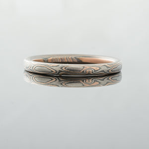Thin mokume gane band wedding ring delicate feminine womens mokume wedding band Rustic and contemporary artisan made Handmade Mokume Gane Ring Wedding Band Red rose gold yellow white gold palladium sterling silver patterned topographical nature inspired mixed metal earthy organic style