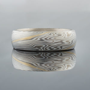 Mokume Gane Wedding Band or Ring in Twist Pattern with 14K White Gold Inner Liner and 14k Yellow Gold Center Stratum Layer artisan made handmade white metal mixed metal two toned yellow gold white gold wedding band unique mens