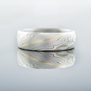 Classic Mokume Gane wedding ring with 14kt yellow gold stratum.