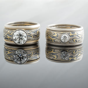 Unique Mokume Gane Wedding Band Set in 18K gold with loose rails and and diamonds.