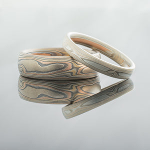 mokume gane matching wedding bands ring set oxidized silver, red and yellow white gold palladium mokumegane topographical nature inspired tree rings