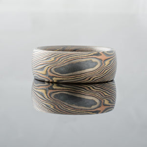 Rustic, black, Red, Handmade mokume gane ring. Hammered