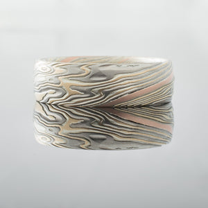Nature inspired woodgrain Mokume Gane Ring Wedding Band. Red gold, white gold sterling silver yellow gold, palladium and silver streaks streaked linear pattern mixed metals two toned