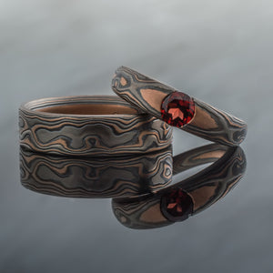 Mokume Gane Ring Artisan Wedding Band Set Embers Palette w/ Cathedral Set Garnet red stone unique artisan made earthy nature inspired woodgrain