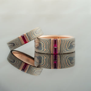Unique Mokume Gane Wedding Ring Set or Bands w/ Rubies and Sapphires ruby stripe channel set woodgrain Pattern black blackened oxidized silver palladium alternative metal nature inspired rustic artisan topographical earthy style unique handmade matching wedding bands mens womens