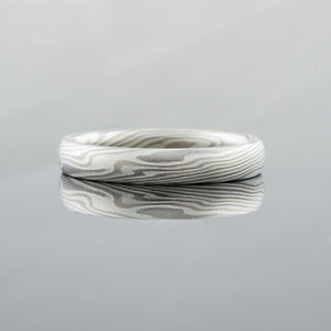 Thin mokume gane women wedding ring in classic and elegant silver and palladium