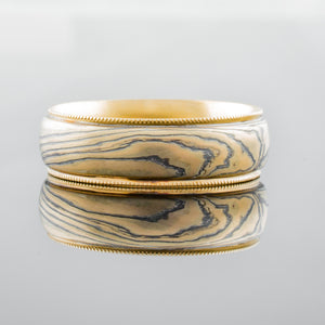 Mokume gane ring mens band with gold rails. Custom and bespoke 14K yellow gold palladium patterned artisan handmade fine jewelry topographical nature inspired mixed metal earthy organic style