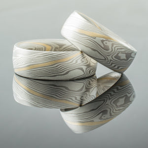 Elegant Mokume Gane Rings or Wedding Band Set in Twist Pattern and Ash Palette with added 14k Yellow Gold Stratum Layer