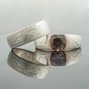 Mokume Gane Rings mens Wedding Set in Firestorm Palette w/ Cathedral Set Oregon Sunstone square silver mixed metal 14K yellow gold white gold two tone two-toned woodgrain Pattern black blackened oxidized silver palladium alternative metal nature inspired rustic artisan topographical earthy style unique handmade matching wedding bands mens womens