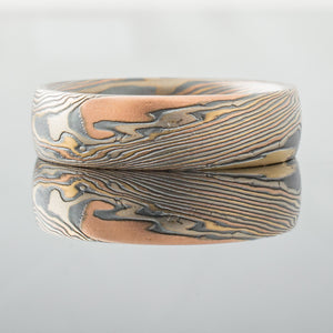Mokume Gane Ring Wedding Band red yellow rose gold with silver and palladium mokume gane mixed metal two tone two-toned artisan crafted nature inspired handcrafted organic contemporary modern earthy topographical tricolor multicolor metal yellow white gold oxidized sterling silver pattern tree rings