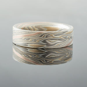 Crafted Mokume Gane Wedding Band or Ring in Etched Flare Palette and Twist Pattern with Red Gold Stratum