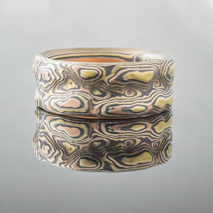 Mokume Gane Ring Wedding Band guri bori nature inspired in gold and silver patterned mixed metal layered two tone two-toned artisan crafted nature inspired handcrafted organic contemporary modern earthy topographical multicolor metal tree rings tricolor snakeskin pattern