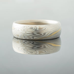 Mokume Gane wedding ring unique silver gold and palladium tricolor mixed metal two tone two-toned artisan crafted nature inspired handcrafted organic contemporary modern earthy topographical multicolor metal yellow white gold sterling silver pattern tree rings