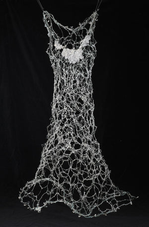 Patinaed copper wire which has been hand woven with glass and resin. Wire Dress Sculpture