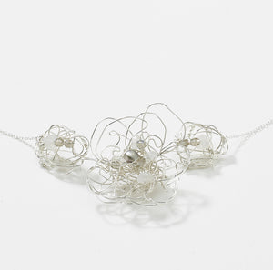 This line drawing necklace is so versatile! A great choice for a bride to be, mothers day, or everyday wear.  Featuring organic line drawn flowers with sparkling accents of moonstone, pearls and labradorite. Sure to catch the light and an eye or two.