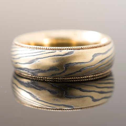 Mokume Woodgrain Ring in Oxidized Spark with Yellow Gold Lining and Milgrain Rails