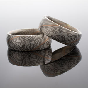 Mokume Gane Matched Wedding Band Set in Twist Pattern and Ash Palette w/ Red Gold Stratum