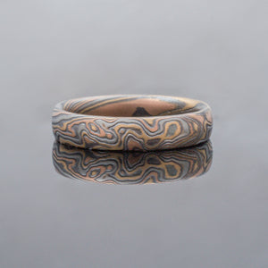 Mokume Gane Wedding Ring or Band in Twist Pattern. Artisan made & bespoke Mokume Gane Ring or Wedding Band in Embers Palette and Woodgrain Pattern Mokume Gane Rings or silver mixed metal 14K yellow gold white gold two tone two-toned woodgrain Pattern black blackened oxidized silver palladium alternative metal nature inspired bohemian rustic japanese style artisan topographical earthy style unique handmade wedding band mens womens