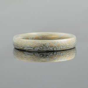 Mokume Gane Wedding Band or Ring in Spark Palette and Twist Pattern Mokume Gane Ring or mens Wedding Band matching wedding bands custom bespoke 14k yellow gold white gold woodgrain Pattern silver palladium alternative metal nature inspired rustic artisan topographical earthy style unique handmade matching wedding bands mens womens custom wedding bands
