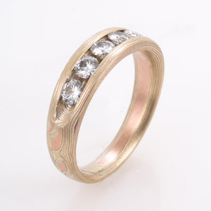 mokume gane wedding jewelry engagement ring with moissonite in sterling silver, red gold and yellow gold