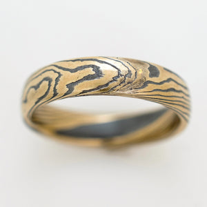 mokume gane ring wedding band in gold and oxidized silver