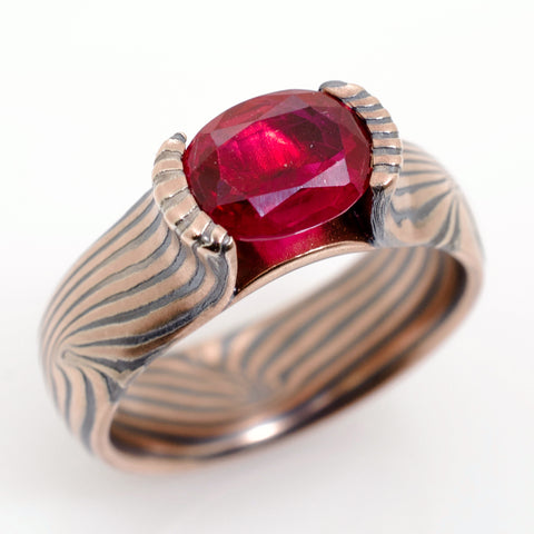 Mokume Wave Ring in Oxidized Spark with Ruby