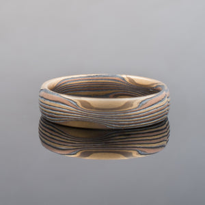 Bespoke wedding rings. Mokume gane in red gold, yellow gold and silver