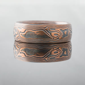 red gold, oxidized silver rustic hammered mokume ring