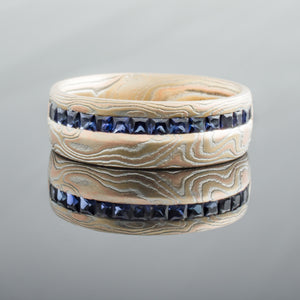 Unique Mokume Gane Ring or Wedding Band Channel Sert in Woodgrain Pattern and Fire Palette with Sapphires