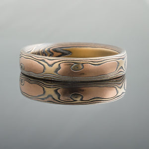 woodgrain mokume gane band with red and yellow gold