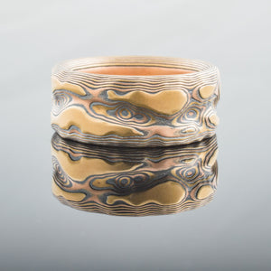 Natural Mokume Gane Guri Bori Band in Fire Palette with an etched finish