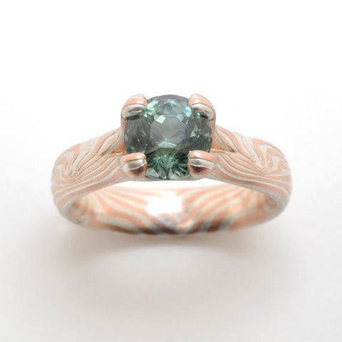 Mokume Gane Engagement Ring in 14k Red Gold and Sterling Silver with 6mm Aqua Green Montana Sapphire set in a Split Prong