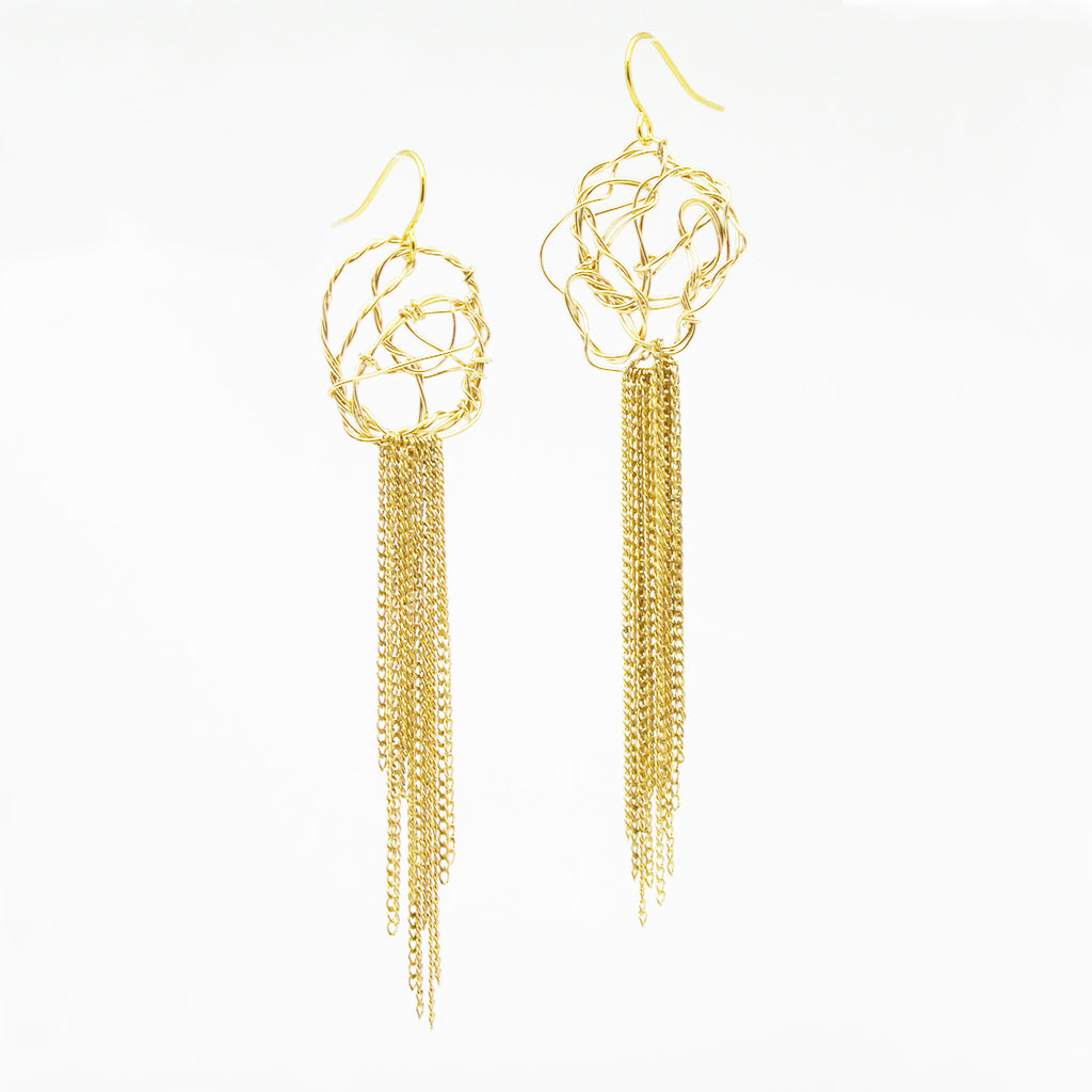 Classical and contemporary earrings with a cascade of chain.  Light, organic, and easy to wear.  2""