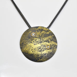 Cosmic Fused 22kt Gold and Oxidized Silver Pendant with Flush Set Diamonds by Arn Krebs