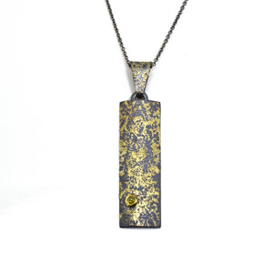 Cosmic Fused 22kt Gold and Oxidized Silver Pendant with Flush Set Yellow Diamond by Arn Krebs