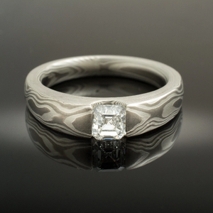 mokume gane wedding ring. mokume gane engagement ring with asscher cut diamond set in cathedral setting