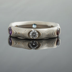 unique mokume ring band with diamond rubies and gemstones