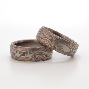Mokume gane rings or wedding bands Arn krebs, embers palette and woodgrain pattern, red gold palladium and sterling silver