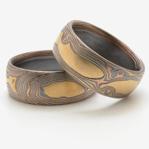 Matched Rustic Knotty Wood Grain Mokume Bands in 14k Yellow Gold, 14k Red Gold, and Sterling Silver with Etched and Oxidized Finish