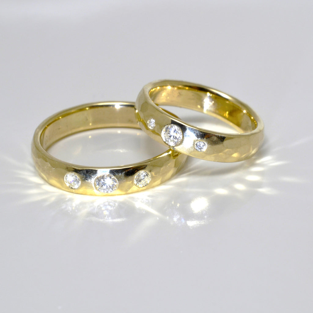 Hers & Hers Hammered 14kt Yellow Gold Wedding Rings with Flush Set Diamonds