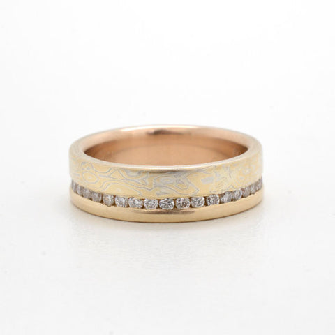 Droplet pattern Mokume band with Channel Set Diamonds and gold rail in 14k Yellow Gold and Sterling Silver with Satin Finish
