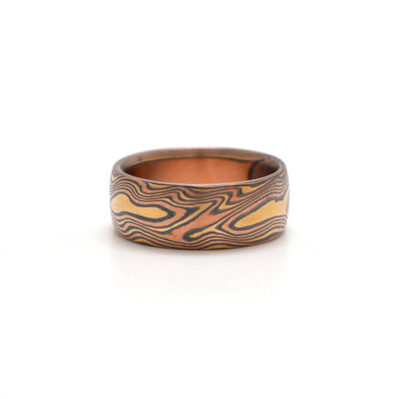 Mokume ring with curly Woodgrain pattern in Red gold, green Gold, and Oxidized Silver
